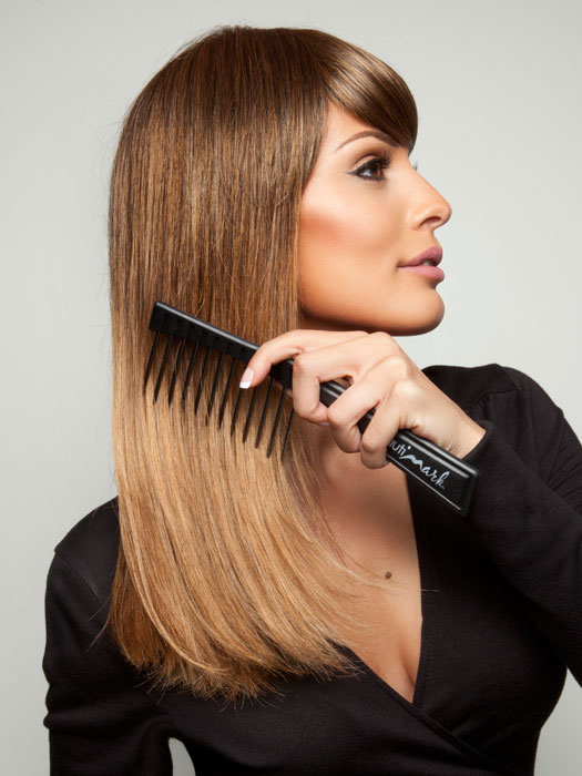 We recommend the Hair Trix Comb by BeautiMark to keep your hair detangled and frizz free (style shown is Lucy by Revlon).