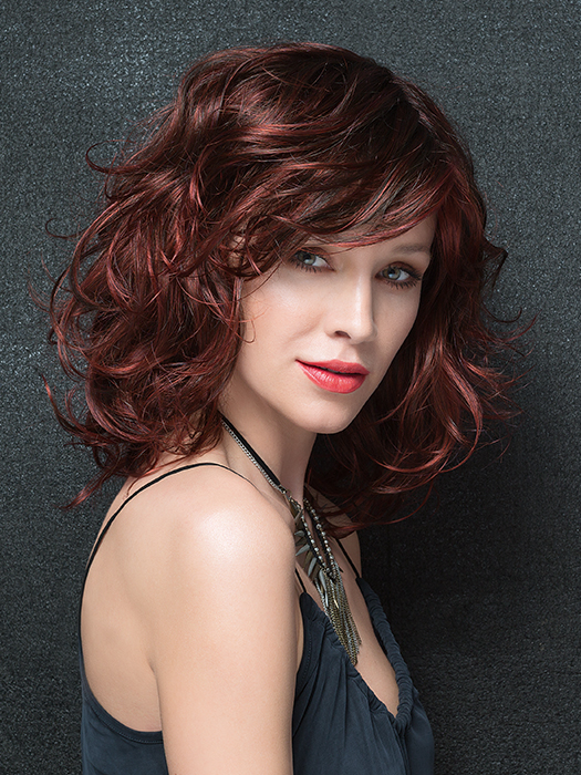 Load is a voluminous, feminine, shoulder-length style with tons of layers and flared ends | Color: Hot Chilli Rooted