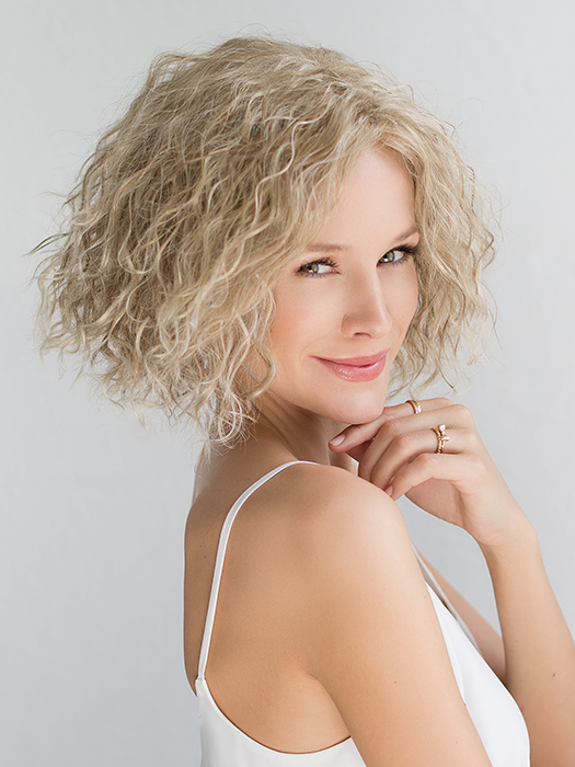 Wiki is a short, unique style that has an edgy take on kinky curls | Color: Champagne Rooted