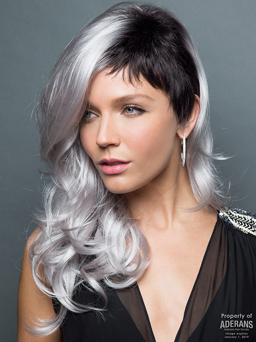 Long, loose  waves accentuated by a short, chic cut on left side. | Color: Illumina-R Violet Silver with Dark Roots.