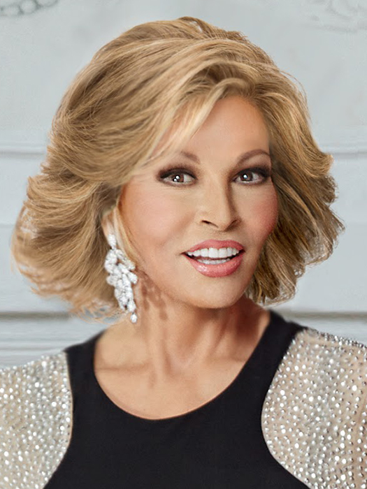 The Art of Chic by Raquel Welch is a 100% Remy human hair wig with lightly feathered layers | Color: R25 Ginger Blonde