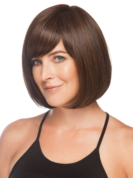 Layers wrap below the jawline giving all face shapes a flattering look. Color Medium Brown
