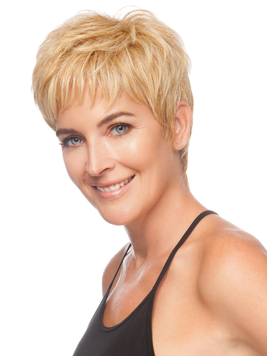 Short jagged bangs frame the face and give coverage. Color Medium Blonde
