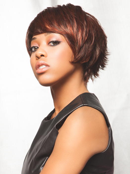 Choppy layers make this cut look modern | Color: Auburn Rooted