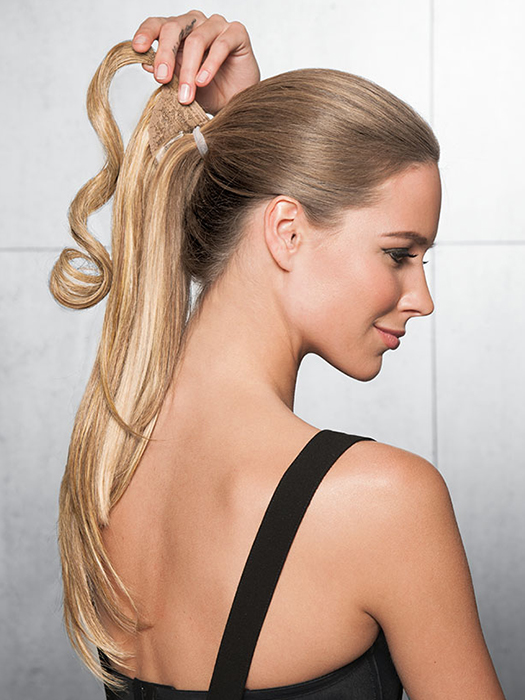 To conceal where the ponytail meets your own hair, a strip of hair wraps around and fastens with Velcro