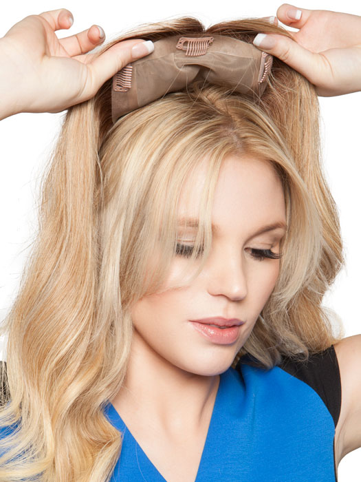 The monofilament base gives styling options and a natural scalp appearance | Clip it from the back then move forward