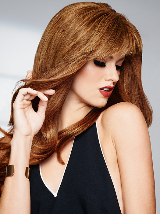 The monofilament base allows for varied parting options   Color: R25